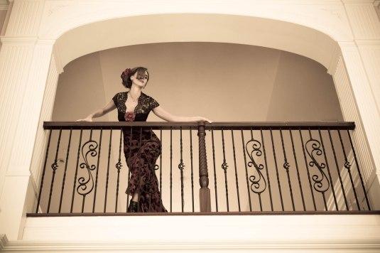 Woman in Balcony by Sharon Birke www.PowerfulGoddess.com