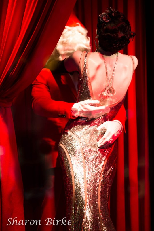 Mommy Kissing Santa Bergdorf Goodman Follies 2012 by Sharon Birke www.PowerfulGoddess.com